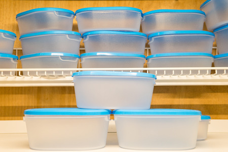Blue plastic boxes of various sizes sold in cookware stores. Plastic can be used to store different types of food as well. Suitable for women who love to organize the kitchen. Stock Photo - 86253239