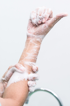 Nurse perform surgical hand washing, Preparation to the operating room. Closed-up of the hands. Stock Photo