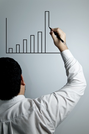 Businessman drawing a graph Stock Photo
