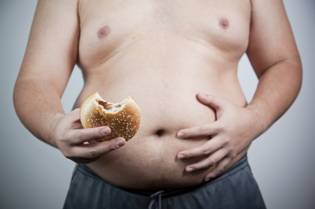 unhealthy lifestyle: Fat man with hamburger isolated Stock Photo