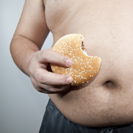 big belly: Fat man with hamburger isolated Stock Photo