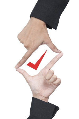Check mark in hand frame Stock Photo