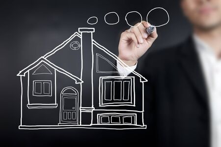 Hand drawing a house photo