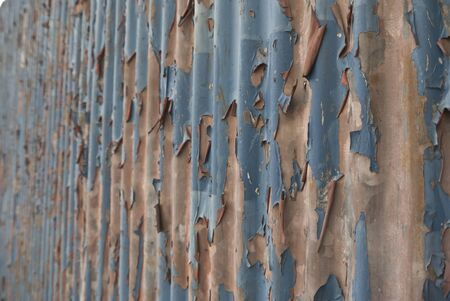 An abstract background image of rusty  iron sheets  to form a wall or fence photo