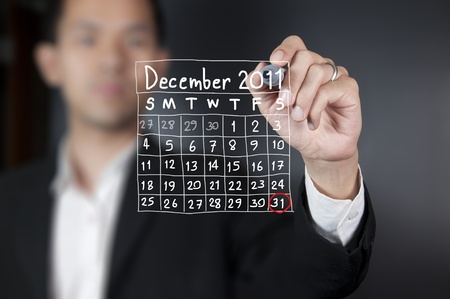Male hand drawing a calendar