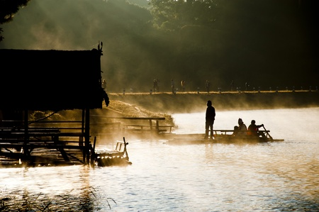 Rowboat in the morning mist