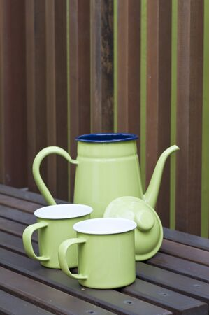 Green kettle and cups photo