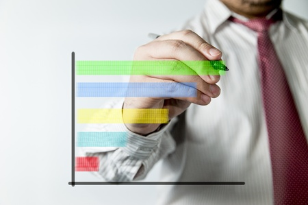 Businessman drawing a chart Stock Photo