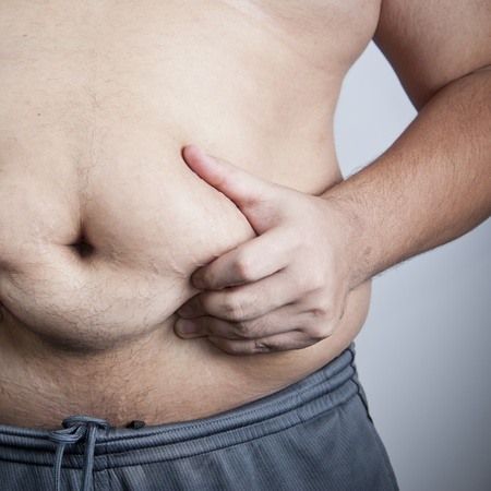 Man grabbing his fat on the stomach