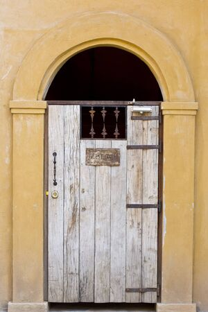 Ancient door and yellow wall, vintage building photo