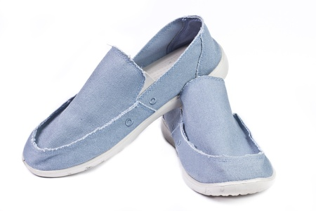 Men blue canvas shoes isolated on white background photo