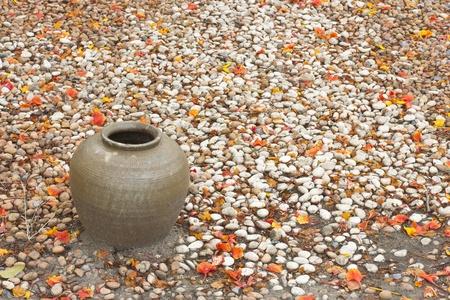 Earthen jar in the garden photo