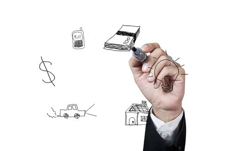 Hand with pen drawing money on white background photo