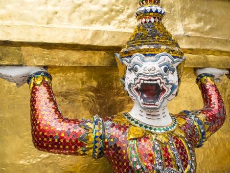 The demon statue on Grand Palace, Temple of the Emerald Buddha Wat Phra Kaew, Bangkok, Thailand  photo
