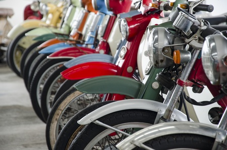 Row of the classic motorcycles on the old street photo