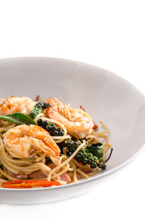 Asian spicy spaghetti with shrimp and herb photo