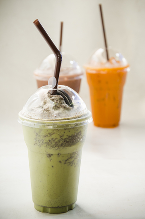 Close up Milk Green tea smoothie in plastic cup Stock Photo