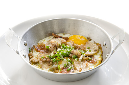 Fried eggs in a small pan photo