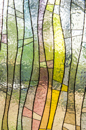 Stained glass window of colored glass photo