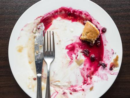 Eaten Pancake with ice cream on dirty plate