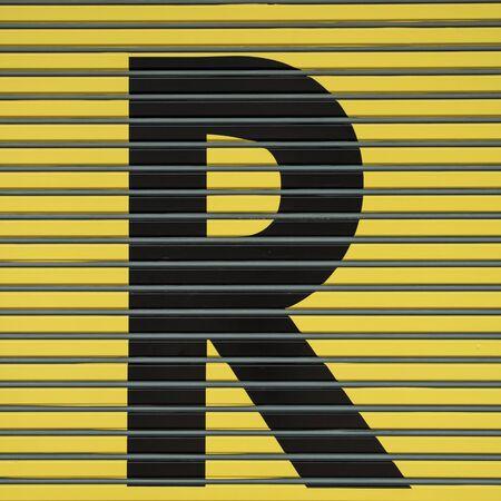 typewrite: Type Alphabet On Yellow Wall