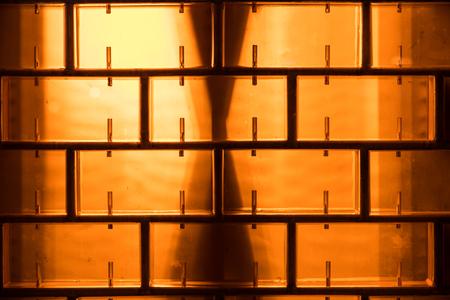 glass block: Pattern of orange glass block wall