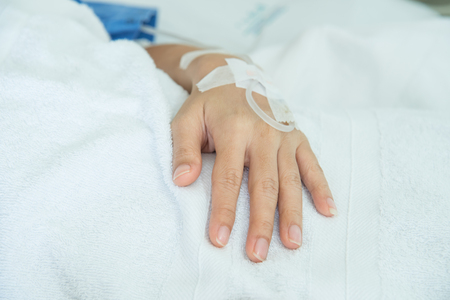 hospital patient: Hand of a patient in hospital ward