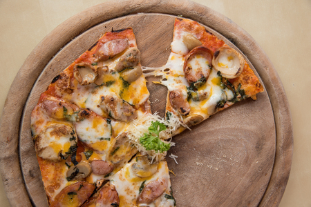feast: Meat feast Barbecue pizza with a topping of pepperoni and sausage