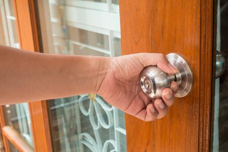 knob: Hand open door knob Stock Photo