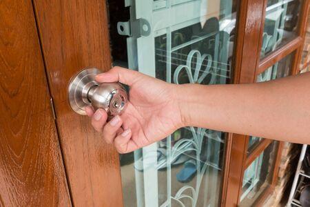 door knob: Hand open door knob Stock Photo