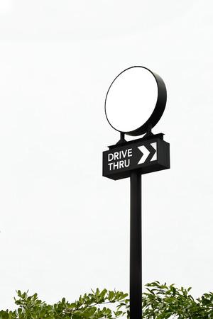 thru: Drive thru and White lightbox pole sign
