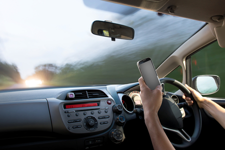 dangers of texting while driving Foto de archivo