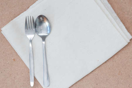 Spoon and Fork on Calico and Wooden Board photo