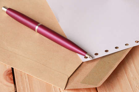 business project: Violet Pen on Document Holder and Paper on Wooden