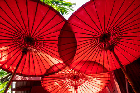 Chinese red oriental bamboo umbrellas.
