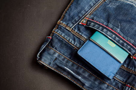 Closeup Passport, wallet, Jeans and Preparing for traveling