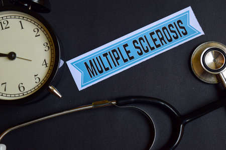 Multiple Sclerosis on the print paper with Healthcare Concept Inspiration. alarm clock, Black stethoscope. Stok Fotoğraf