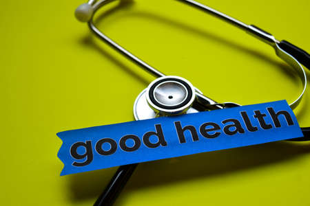 Closeup good health with stethoscope concept inspiration on yellow background