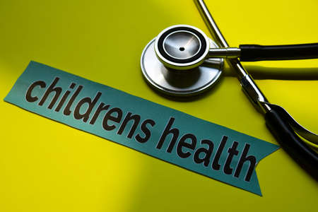 Closeup children health with stethoscope concept inspiration on yellow background Imagens
