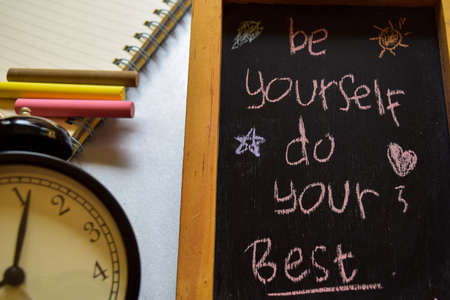 be yourself do your best on phrase colorful handwritten on chalkboard, alarm clock with motivation and education concepts. Stock Photo - 107831134