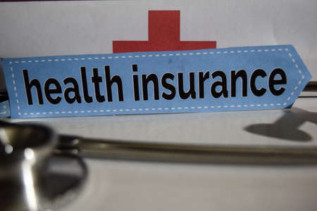 Health insurance message with stethoscope, health care concept. Cross processed image with selective focus Stock Photo