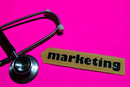 Marketing on the paper with medicare Concept Inspiration. Stethoscope on pink bakcground