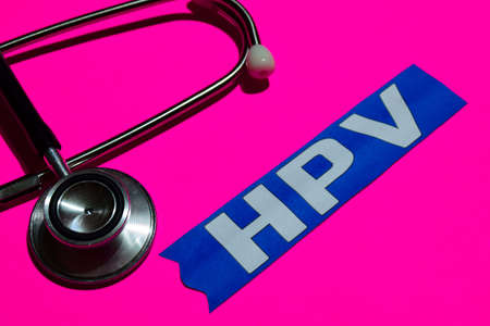HPV on the paper with medicare Concept Inspiration. Stethoscope on pink bakcground