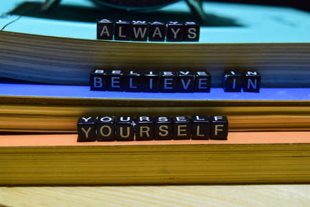 Always believe in yourself written on wooden blocks. Education and business concept on wooden background Stock Photo