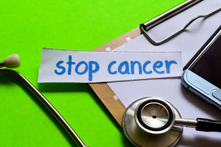 Stop cancer on healthcare concept inspiration with green background