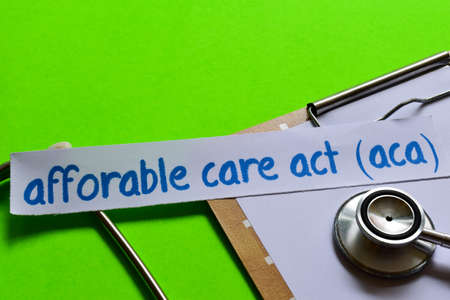 Affordable care act (ACA) on healthcare concept inspiration with green background Stock Photo