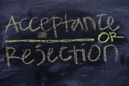 Acceptance or Rejection written with color chalk concept on the blackboard Reklamní fotografie