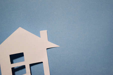 House of white paper showing a concept for home on blue background. Top view. Stock Photo