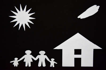 concept image of make your a house. Paper cut of family with house and tree