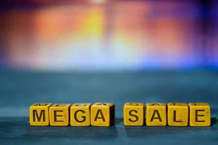 Mega sale on wooden blocks. Cross processed image with bokeh background